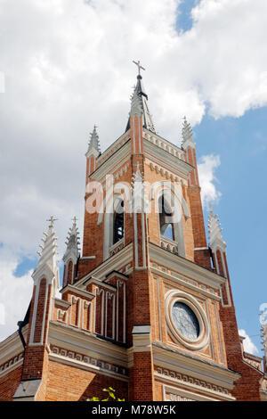 Exterior of Catholic Church of the Dormition of the Holy Virgin Mary on a sunny day in Kharkiv, Ukraine - Stock Photo