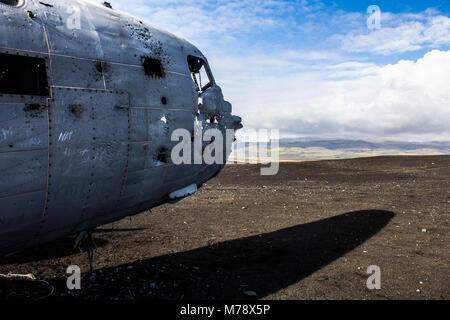 crashed United States Navy Douglas Super DC-3 plane on Sólheimasandur beach in Iceland - Stock Photo