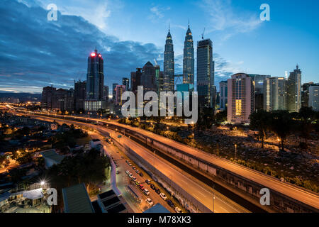 Kuala Lumpur skyline and skyscraper with highway road at night in Kuala Lumpur, Malaysia. Asia. - Stock Photo