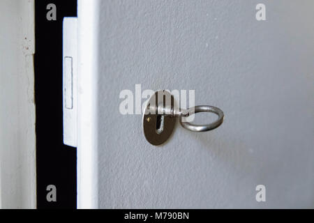 Door lock key open isolated on white - Stock Photo