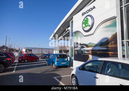 NUERNBERG / GERMANY - MARCH 4, 2018: Skoda logo on a car dealer in Germany. Skoda is a Czech automobile manufacturer - Stock Photo
