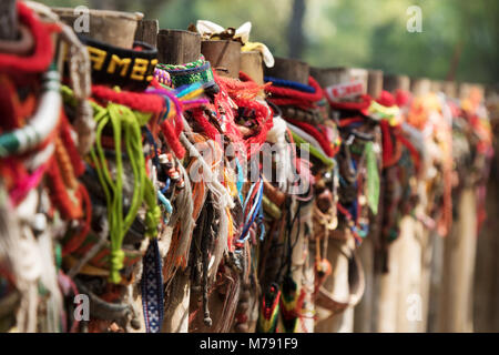 Cambodia killing fields - colourful memorial ribbons tied around the mass graves by tourists; Choeung Ek Killing - Stock Photo
