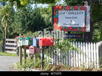 Clay Gallery sign and letter boxes, Moutere Highway, Upper Moutere, Tasman District, New Zealand - Stock Photo