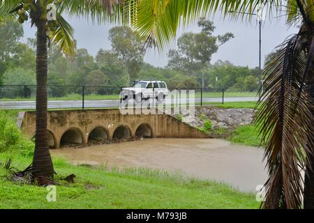 Debris of sticks and branches builds up on storm water drains under a bridge after storms and heavy rainfall, Townsville, - Stock Photo
