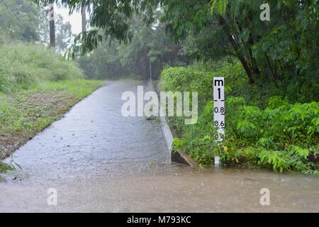 Flooded pedestrian and bike path after storms and heavy rainfall, near the bruce highway annandale, Townsville, - Stock Photo