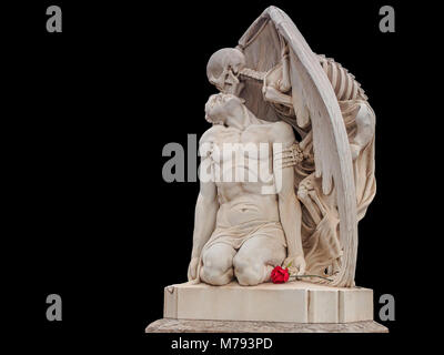 Kiss of death statue with a red Rose isolated on black background - Stock Photo
