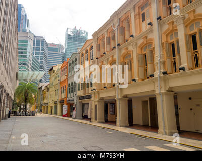 Pastel coloured facades of traditional shophouses in Hokien Street, Chinatown, Singapore. - Stock Photo