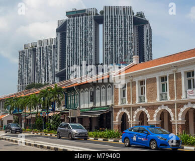The Pinnacle@Duxton high rise residential apartments and a row of traditional Shophouses on South Bridge road, Singapore. - Stock Photo