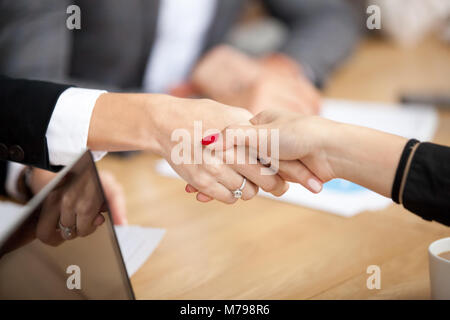 Businesswomen handshaking at group meeting, female hands shaking - Stock Photo