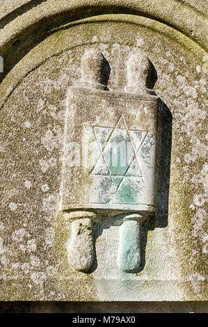 A decorative element showing a torah scroll on a gravestone marks the grave of a religous man in the Okopawa Street - Stock Photo