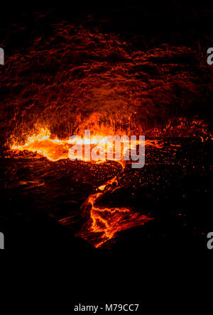 The active erta ale volcano spitting its living and burning lava from its crater, Afar region, Erta ale, Ethiopia - Stock Photo