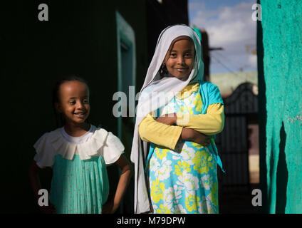 Girls in the colorful streets of the old town centre, Harari region, Harar, Ethiopia - Stock Photo