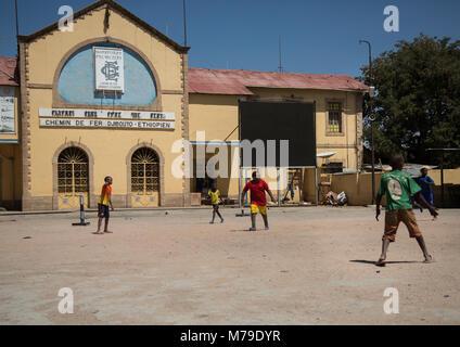 Kids playing football in front of the station of the ethio-djibouti railway, Dire dawa region, Dire dawa, Ethiopia - Stock Photo