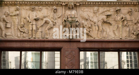 Ornate facade with bas relief sculptures in Leeds, UK. The building stands on Park Row. - Stock Photo