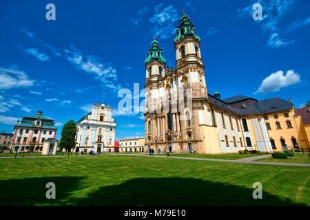 Baroque style Basilica of the Assumption of the Blessed Virgin Mary in Krzeszow, Poland. The church is a part of - Stock Photo