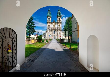 Entrance gate to former Cistercian abbey complex. Baroque style Basilica of the Assumption of the Blessed Virgin - Stock Photo