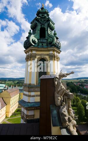 Top view of the tower of Baroque style Basilica of the Assumption of the Blessed Virgin Mary in Krzeszow, Poland. - Stock Photo