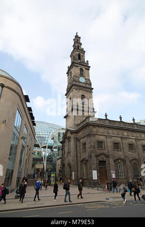 The Holy Trinity Church in Leeds, UK. The place of worship stands next to the Leeds Trinity shopping mall. - Stock Photo