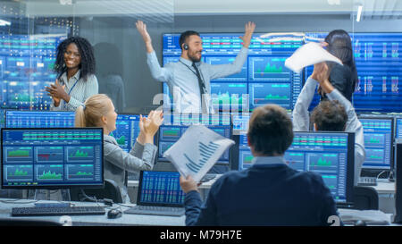 Multi-Ethnic Team of Traders Have Successful Day at the Stock Exchange Office. Dealers and Brokers Buy and Sell - Stock Photo
