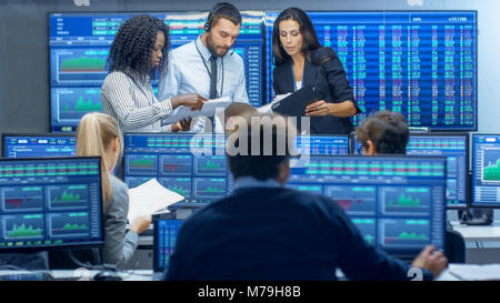 Multi-Ethnic Team of Traders is Busy Working at the Stock Exchange Office. Dealers and Brokers Buy and Sell Stocks - Stock Photo