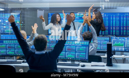 Multi-Ethnic Team of Traders Have Successful Day at the Stock Exchange Office. Dealers and Brokers Celebrate Successful - Stock Photo