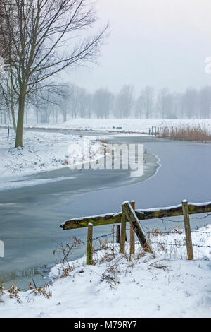 View down the Old West River covered in ice, Cambridgeshire - Stock Photo