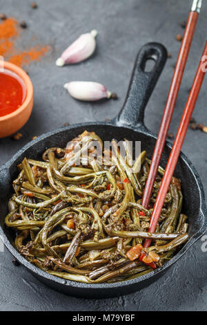 Spicy salad of fern with onion, garlic, soy sauce and spices. Dish Eastern and Asian cuisine. Selective focus - Stock Photo