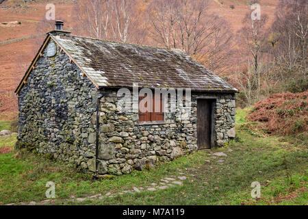 Old stone cottage at Ashness Bridge, Lake District, England - Stock Photo