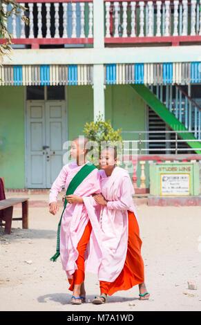 Young novice nuns at Aung Myae Oo Monastic Free Education School, Sagaing, Mandalay, Myanmar (Burma), Asia in February - Stock Photo