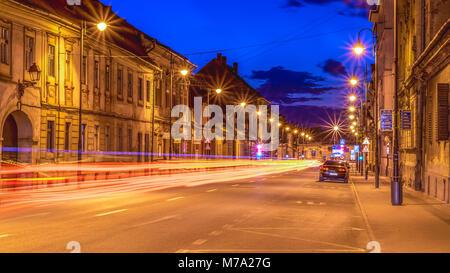 Beautiful night street at sunset in Sibiu, Romania - Stock Photo