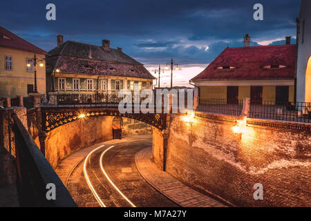 The Bridge of Lies at sunset in Sibiu, Romania - Stock Photo