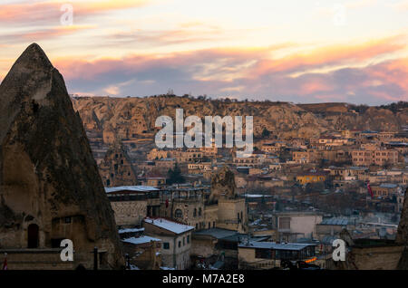 Pink cloudy sunset over the city of Goreme, Cappadocia, Turkey - Stock Photo