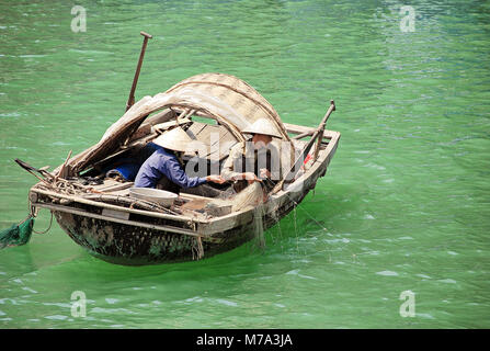 Vietnamese fishermen in Ha Long Bay. They live in floating villages in the bay in the Gulf of Tonkin. - Stock Photo
