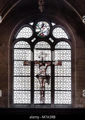 Paris, France - January 7, 2018: Jesus on the cross painted on the glass of a window inside the church of St. Stephen's - Stock Photo