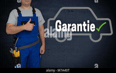Garantie (in german Guarantee) car and craftsman with thumbs up. - Stock Photo