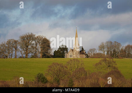 View from a distance of St Matthews church, Midgham, Berkshire, England, UK - Stock Photo