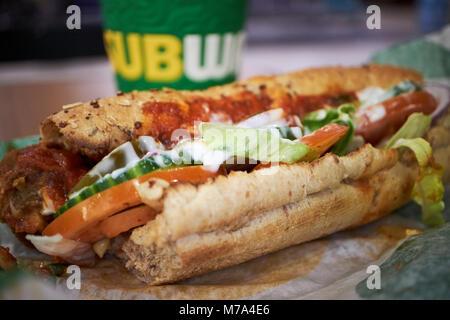 Subway six inch meatball marinara sandwich in the uk with coffee - Stock Photo