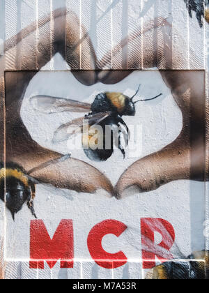 Street art in Manchester's Northern Quarter. The Love MCR design is part of the response to the terrorist attack - Stock Photo