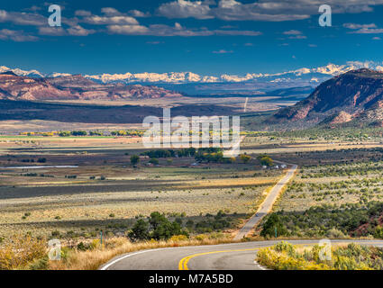 Paradox Creek Valley, San Juan Mountains in far distance, 75 miles or 120 km SE, view from Highway 90, near town - Stock Photo