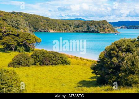 Yacht in Entico Bay on Urupukapuka Island in the Bay of Islands, North Island, New Zealand - Stock Photo