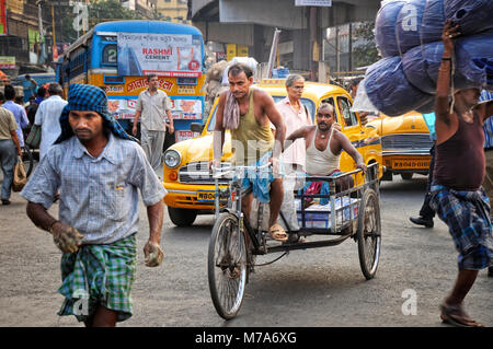 Rickshawman in the streets of Kolkata. India - Stock Photo