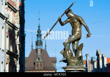Neptune Fountain - symbol of Gdansk, located at Long Market, blurred roof of the Prison Tower in the background, - Stock Photo