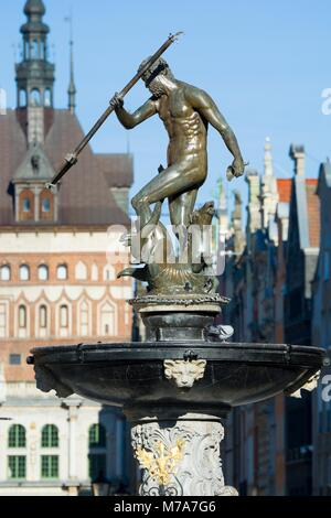 Neptune Fountain - symbol of Gdansk, located at Long Market, blurred Prison Tower and Golden Gate in the background, - Stock Photo