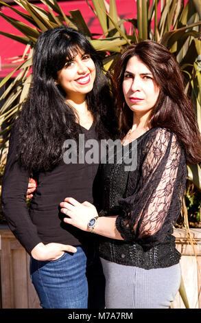 Two female University students, Parisian-Algerian Faiza Faa (left) and friend Samar Munaf from Iraq (right) standing - Stock Photo