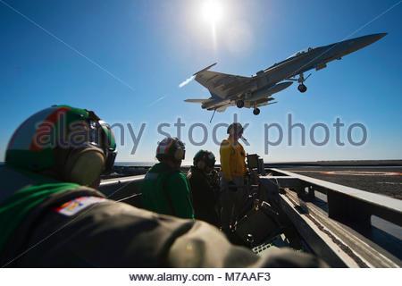 McDonnell Douglas FA-18C Hornet. PACIFIC OCEAN (Feb. 13, 2013) Sailors watch as a McDonnell Douglas F/A-18C Hornetfrom - Stock Photo