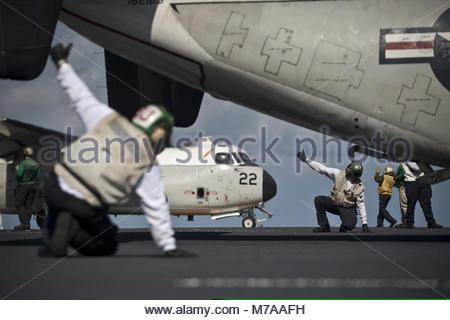 Grumman -Northrop Grumman C-2A Greyhound. U.S. Sailors with Fleet Logistics Support Squadron (VRC) 30 give the all - Stock Photo