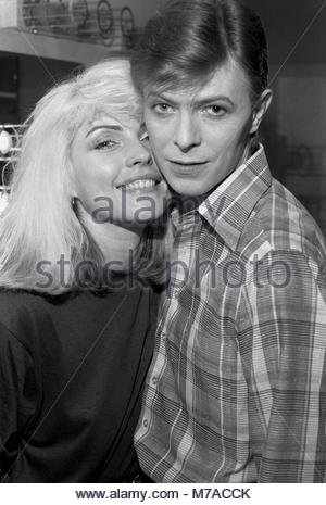 Deborah Ann Debbie Harry  aka Blondie with David Bowie. That is a genuine I am thrilledsmile on her face.  Every - Stock Photo