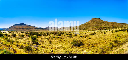 Endless wide open landscape of the semi desert Karoo Region in Free State and Eastern Cape provinces in South Africa - Stock Photo