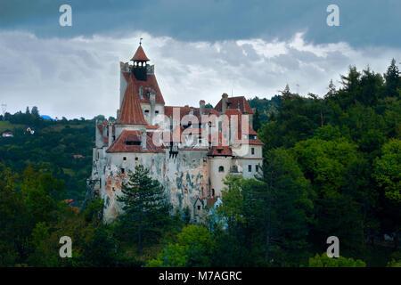 Medieval Bran Castle on mountain in Brasov, Romania - Stock Photo
