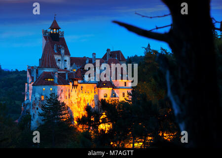 Medieval Bran Castle on mountain in Brasov, Romania - Stock Photo